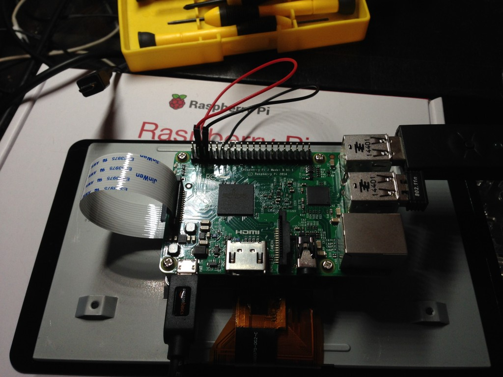The Raspberry Pi mounted to the screen.